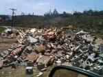 Destroyed Home Piled Up on Side of Road- Care Packages Left For Them